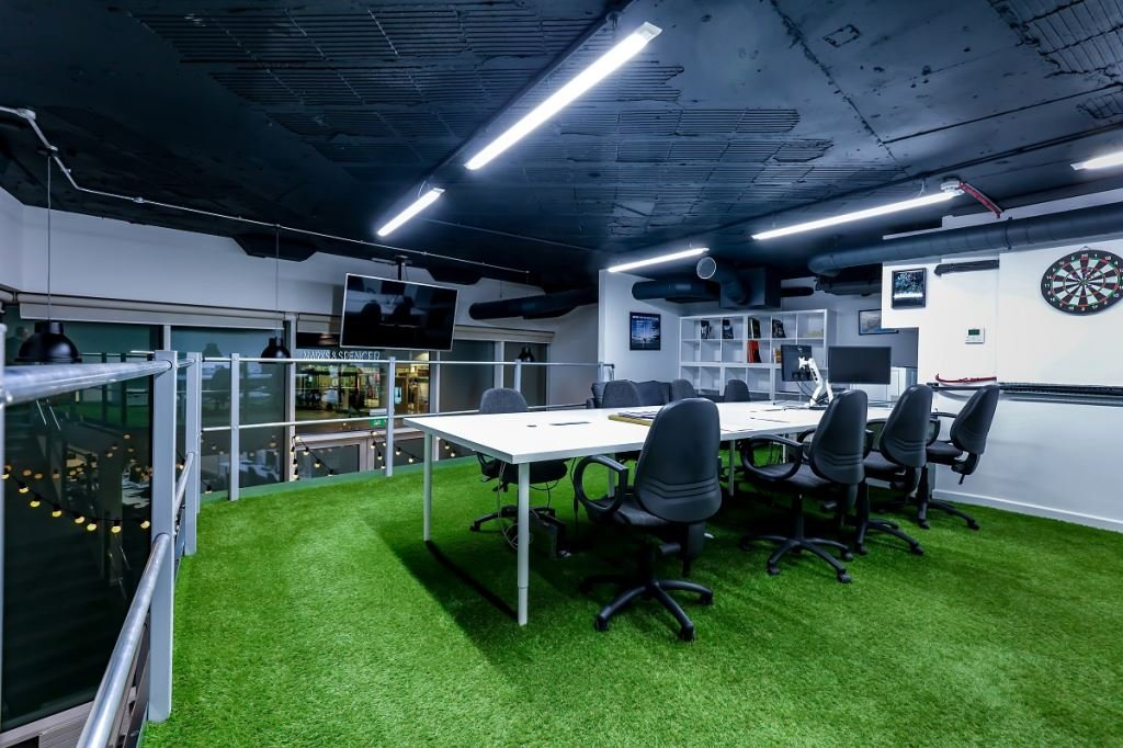 Mezzanine level meeting room in office with artificial grass