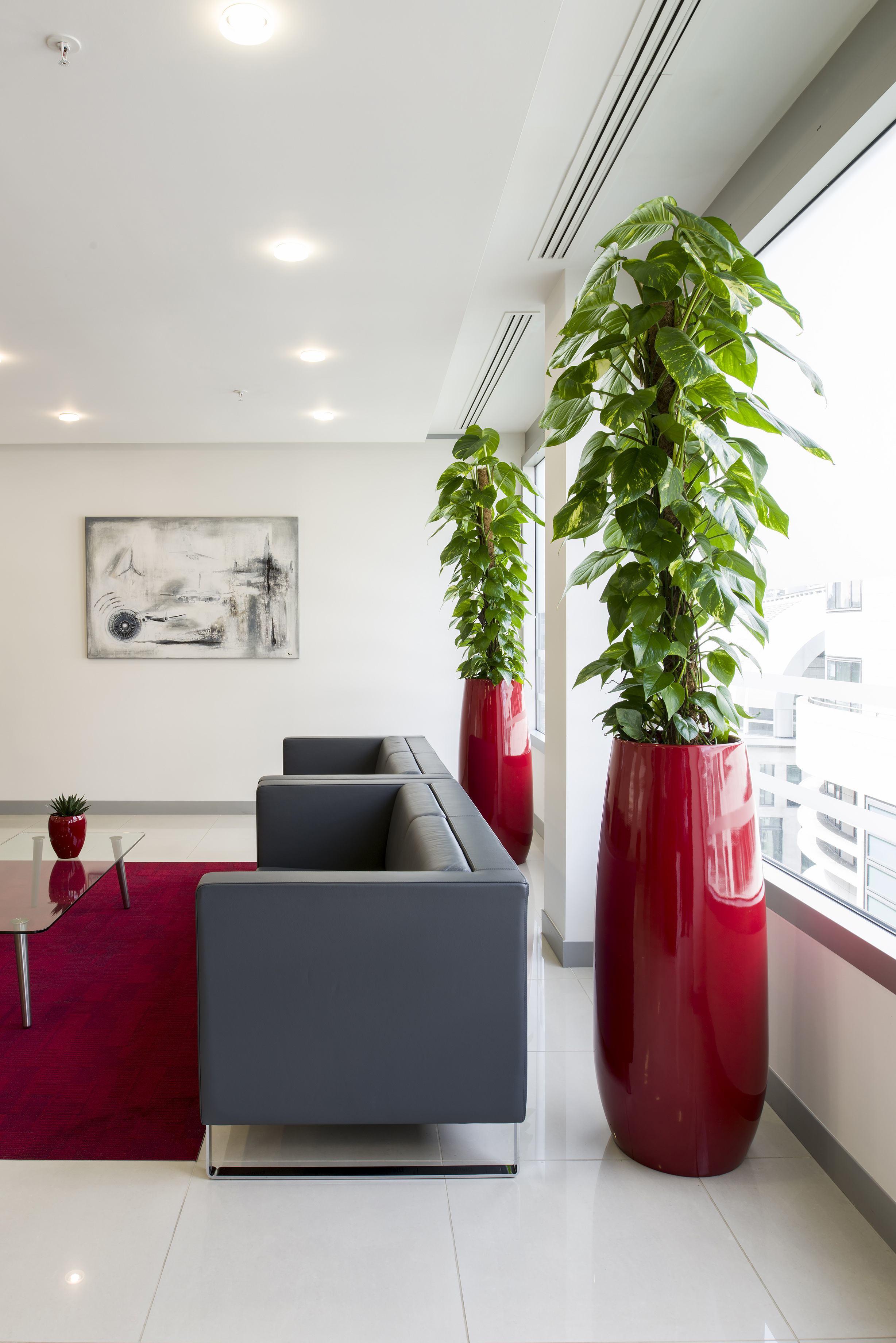office with two large red plant pots