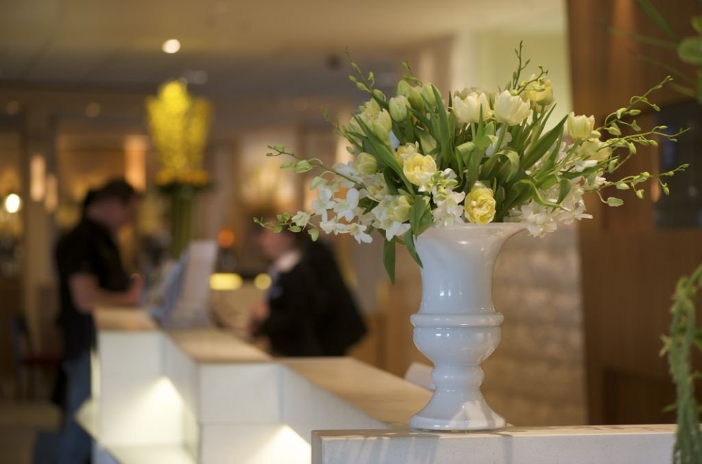 Planteria Group arrangement of flowers on the edge of a hotel reception desk