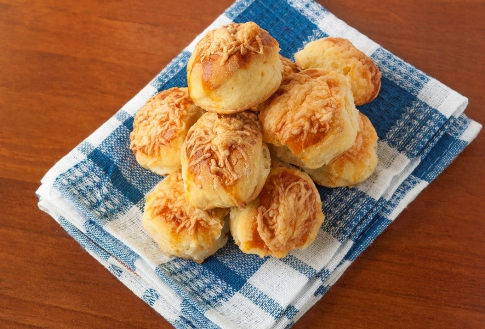 Cheese Scones arranged on a blue gingham tea towel