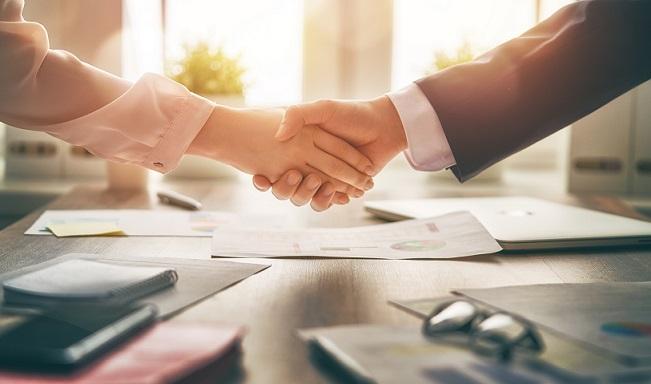 handshake over office table