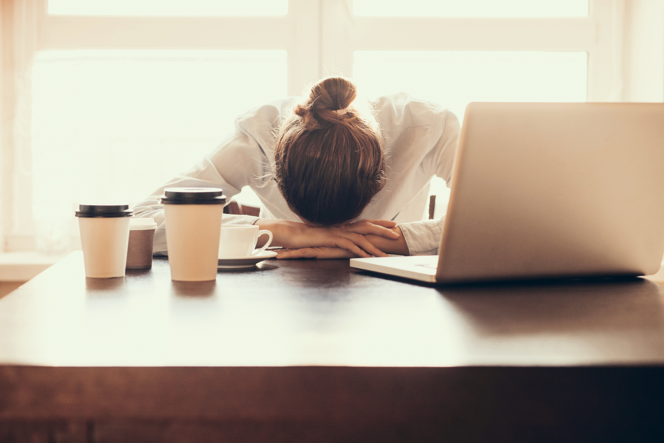 person tired at work desk