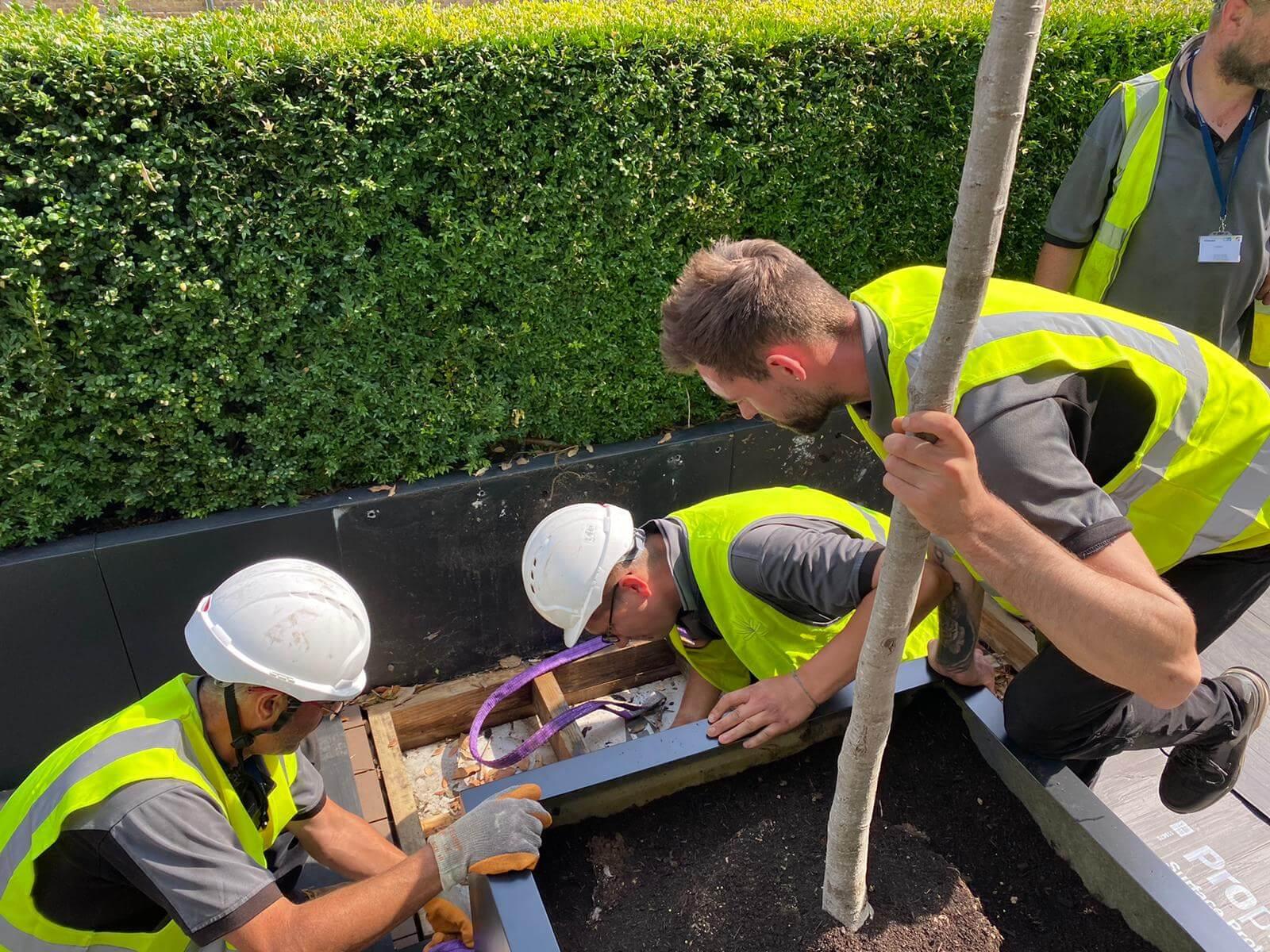 men working with yellow vests