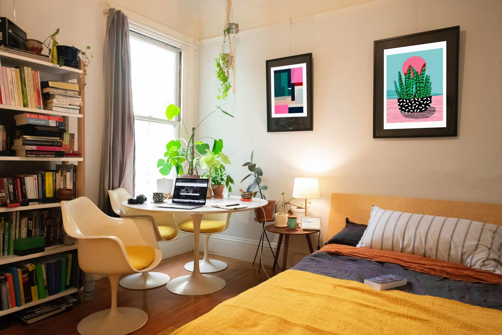 Bedroom setup with art and plants