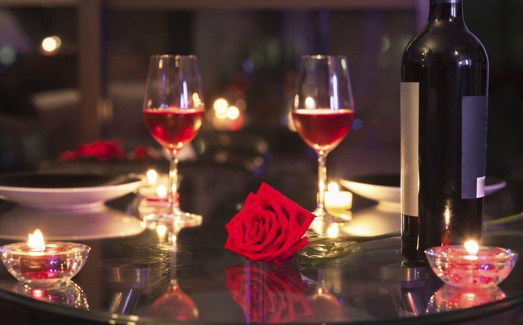 Romantic candlelight dinner setting.