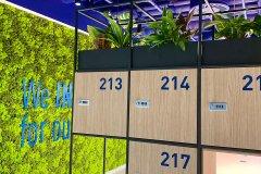 storage lockers next to green wall